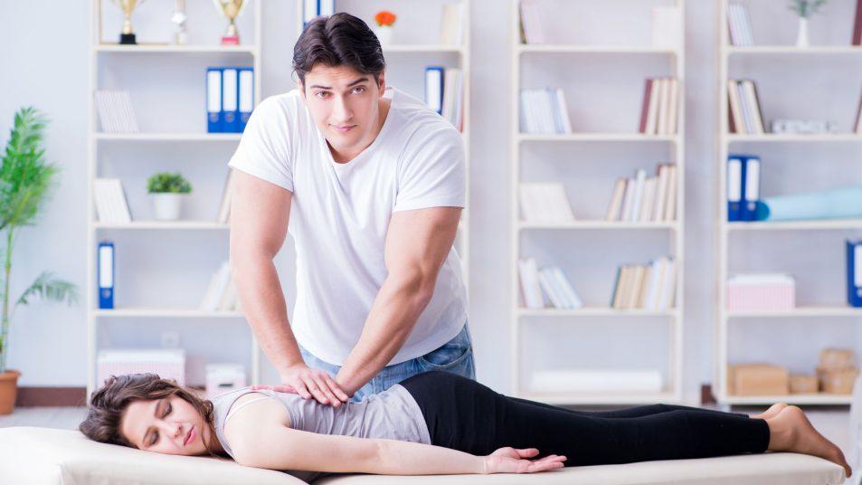 Doctor Chiropractor Massaging Patient